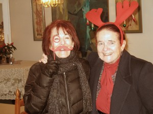 Marie and Beverly in moustache and reindeer horns